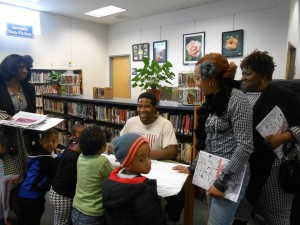 D. Marque signing his coloring books at an event at North Wilmington Branch Library, DE.