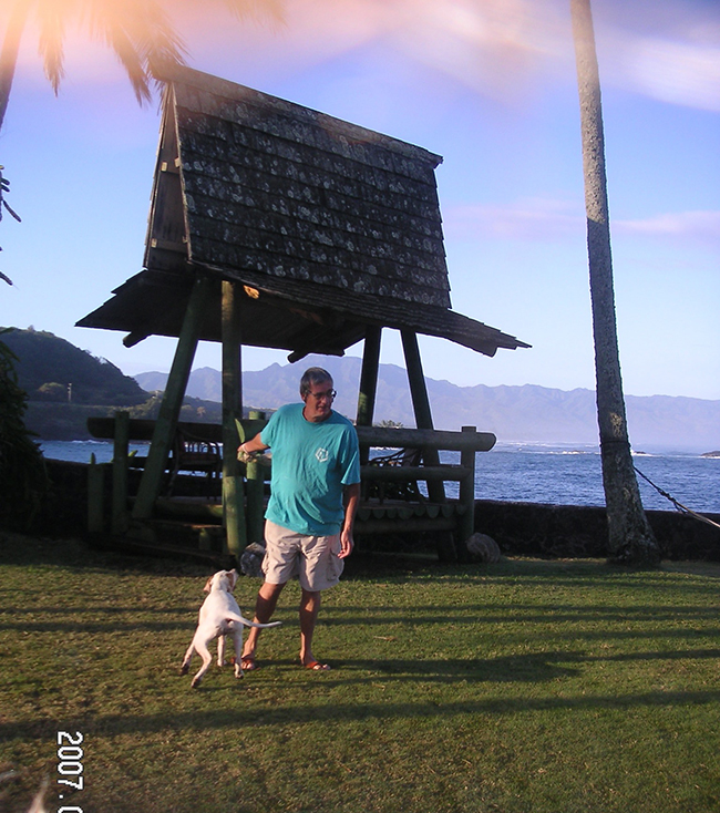 John Bain with throwing the ball with Kiwi at Waimea Point house