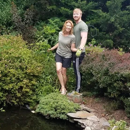 Scott caught this shot today if Griffin and I cleaning up around the pond. Fam resemblance or what?!?Heck we're even dressed alike! Who knew?!? #motherandson #pond #backyardgarden #summer